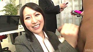 Dirty-minded Japanese office slut Yuuna Hoshisaki jerks off cock with joy