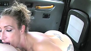 Tattooed busty gal banging in taxi