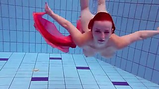 Redhead dancing in the pool
