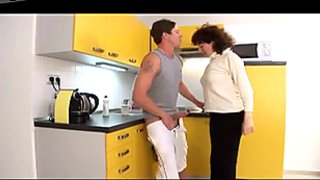Dark haired old slut gives a head to her boy at kitchen