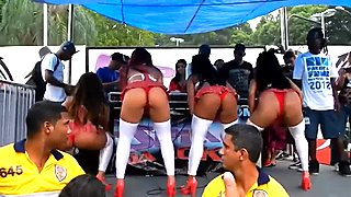 Schoolgirl singing group on stage shaking their hot asses