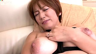 Buxom Asian slut Meguru Kosaka gets her pussy stimulated with vibrator