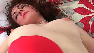 English milf Scarlet masturbates in nylon