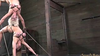 Cherry Torn and her slutty girlfriend are hanged to the ceiling in BDSM sex video