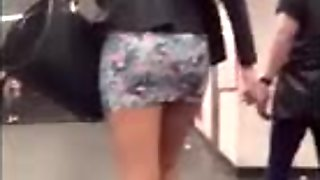 sexy milf walking in short skirt